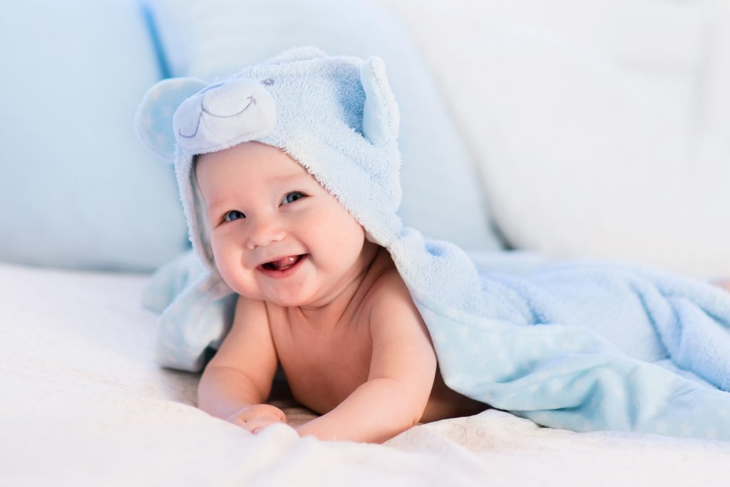 When do babies start smiling and laughing